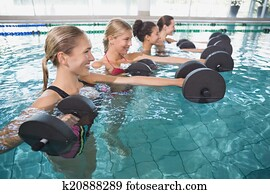 Smiling female fitness class doing