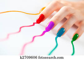 Young woman hand with multicoloured nails