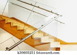 Modern interior with wooden stairs