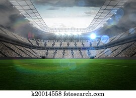 Large football stadium with lights