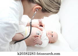Pediatrician with Baby checking possible heart defect