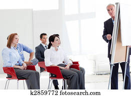 Multi-ethnic business people at a seminar