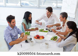 Business people eating lunch togeth