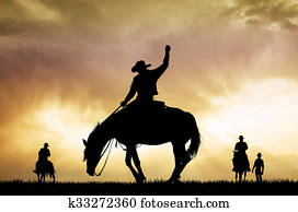 rodeo cowboy silhouette at sunset