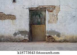 beautiful old wooden door with old wall texture