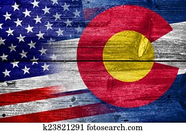 USA and Colorado State Flag painted on old wood plank texture