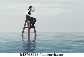 Young man sits on a ladder