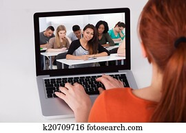 Female Student Attending Online Lecture On Laptop