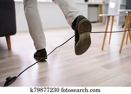 Man Legs Stumbling With An Electrical Cord