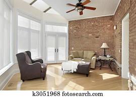 Sun room with brick wall