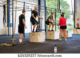 Athletes Exercising At gym