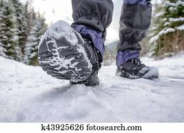 Hiking boots in snowy forest