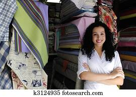 happy owner of a fabric store