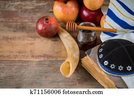 Honey and apples on jewish holiday Rosh Hashanah torah book, kippah a yamolka talit
