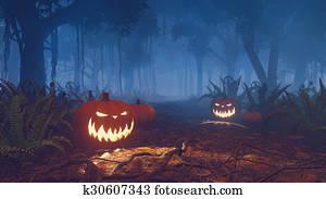 Halloween pumpkins in a misty forest close up