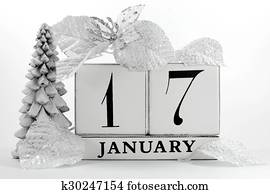 Save the Date vintage shabby chic block calendar with white winter theme snow covered pine tree, snowflake, and poinsettia flowers, for birthdays, events, weddings, or website events, for January 17.