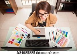 Cute freelance designer at work
