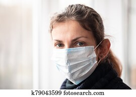 Woman with virus protection mask against pandemic of coronavirus COVID-19