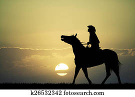 man on horse at sunset