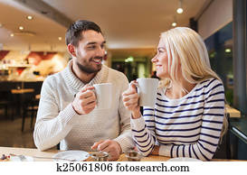 happy couple meeting and drinking tea or coffee