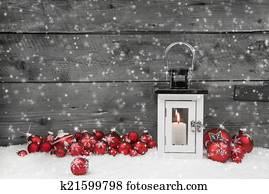 White shabby chic latern for christmas with candle and red balls