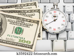 Hundred dollar bills on computer keyboard with spacebar Stock Image