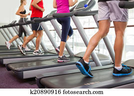 Row of people on treadmills