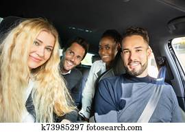 Happy Friend Sitting Inside Car Looking At Camera