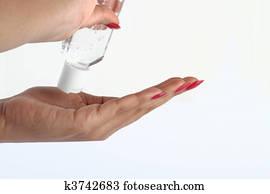 Using hand sanitizer - Hygiene concept