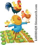 Scarecrow and chickens in vegetable garden