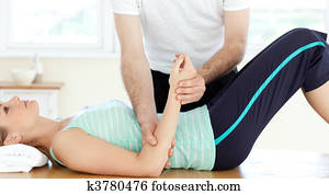 Attractive young woman receiving a massage