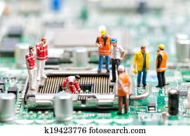 Team of engineers repairing circuit board