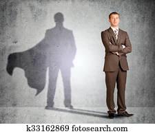 Businessman with superman shadow