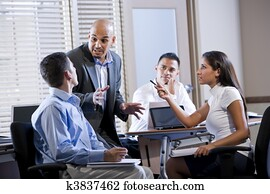 Manager meeting with office workers, directing
