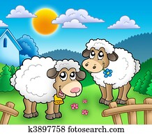 Two cute sheep behind fence