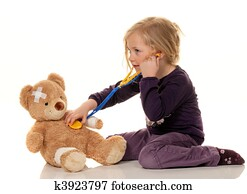 Child with a stethoscope as a doctor. Pediatrician examined patients