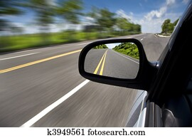 car driving through the empty road and focus on mirror