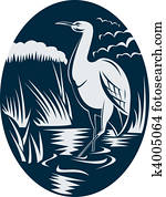 Heron wading in the marsh or swamp done in retro woodcut style.