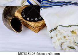 Yom Kippur, Rosh Hashanah Hashana jewish New Year, Shemini Atzeret Shmini Atzeret and Simchat Torah holiday concept with shofar traditional Israel's ram horn with religious holy prayer book