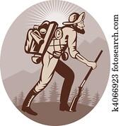 Miner prospector hunter trapper hiking with sunburst in background
