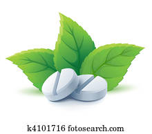 natural medical pills with green leaves