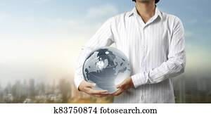 Glass globe in hand, Energy saving concept, Elements of image furnished by NASA