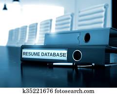 Resume Database on Ring Binder. Blurred Image.