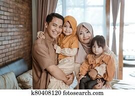 beautiful muslim family smiling