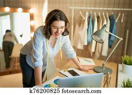 Woman is working at workshop