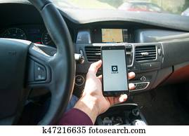 Driver starting uber application with new logo