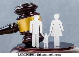Family figure and gavel on table.