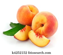 fresh peach fruits with green leaves