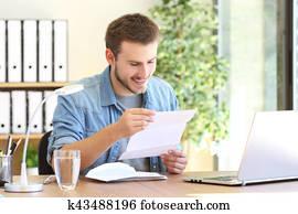 Happy entrepreneur reading a letter