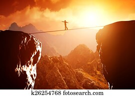 Man walking and balancing on rope